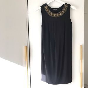 Black dress with brass embellishments